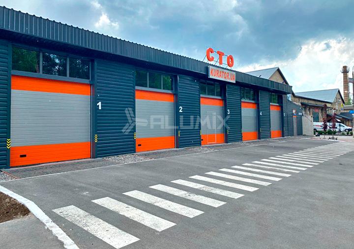 Промышленные секционные ворота ProTrend и двери для СТО